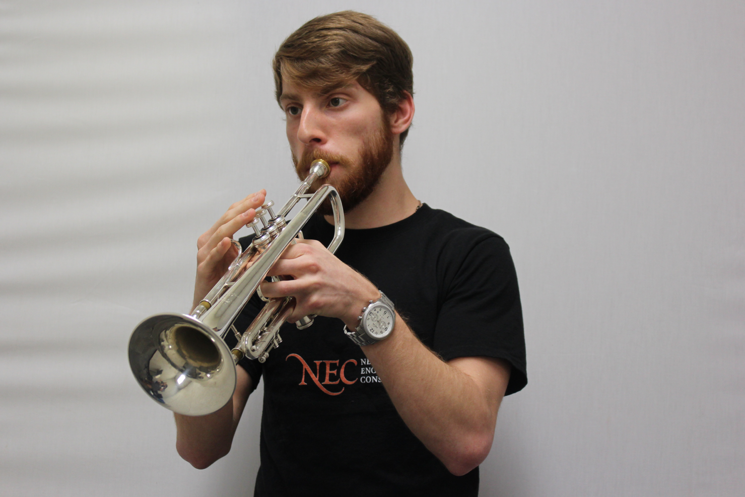 Coppell High School senior Grant Knippa practices trumpet in the CHS band hall practice rooms during sixth period. Knippa plans to attend New England Conservatory of Music in Boston to pursue a career in classical music.