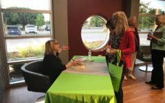 On Friday night at the Cozby Library and Community Commons, best-selling author Julia Heaberlin signs books. Heaberlin visited the library to interact with and answer questions from readers and aspiring writers.