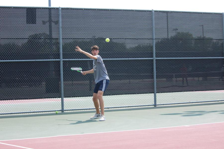 During eighth period on Wednesday, CHS9 freshman Kosta Zrnic returns a serve during practice. The varsity team continues to prepare for the upcoming match against Irving Macarthur on Tuesday.