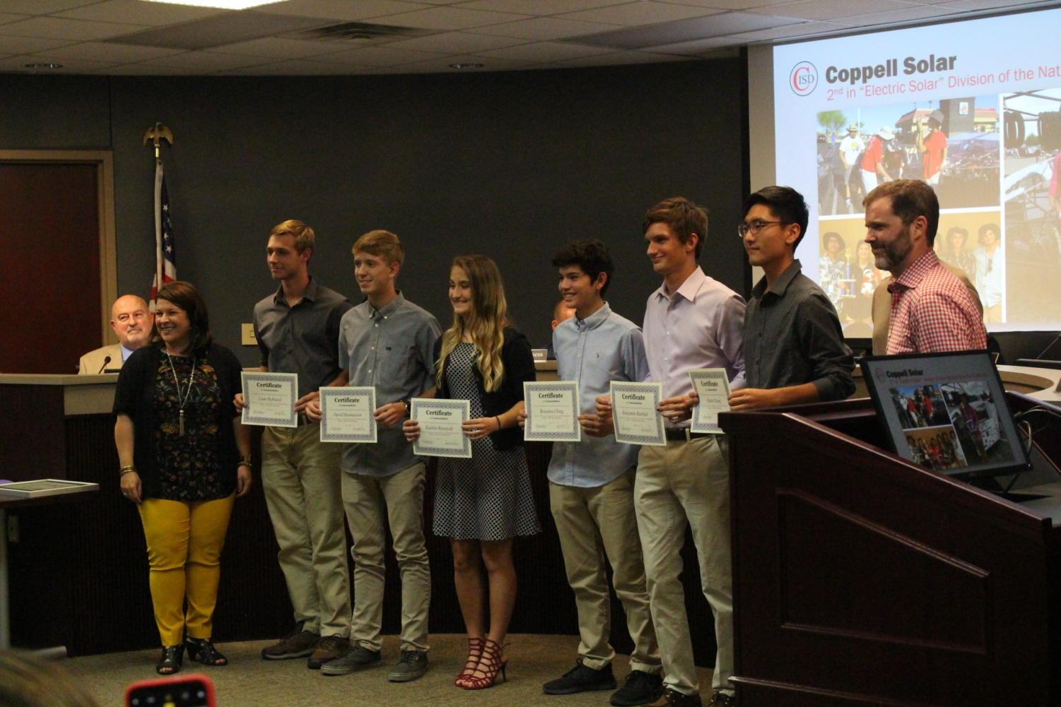 Coppell High School Solar team smiles after getting recognized at the CISD board meeting on Monday in the Vonita White Administration Building. The Solar team participated in 2018 National Solar Car Challenge, and Coppell seized second place in the electric car division.