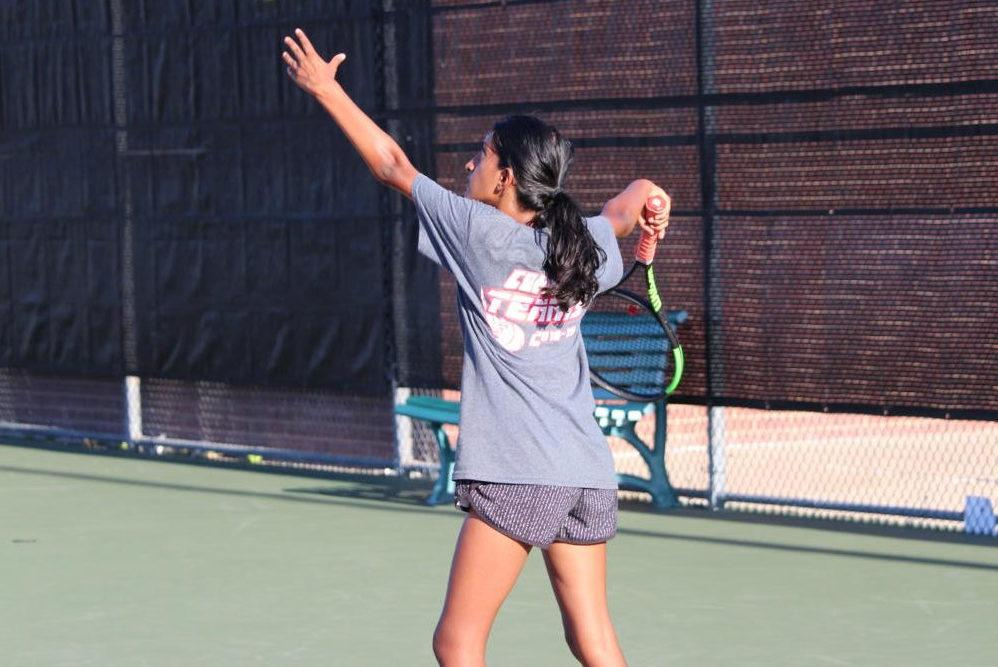 Yesterday, Coppell High School junior Aishwarya Kannan returned the opponent's shot during her singles match. Coppell played against MacArthur at the CHS tennis center for their first district game, and won 19-0.