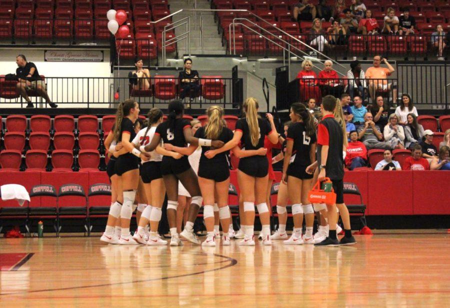 The Coppell High School varsity volleyball team huddled together to pray before its game against the McKinney Lady Lions. The Lady Lions took the victory in four sets last Tuesday in the CHS Arena.