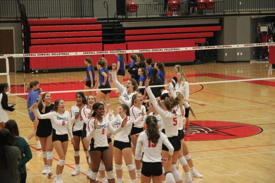 Coppell+High+School+Varsity+volleyball+team+celebrates+their+victory+against+Byron-Nelson+Tuesday+night+in+the+CHS+Arena.+The+Cowgirls+won+the+game+3-0.+
