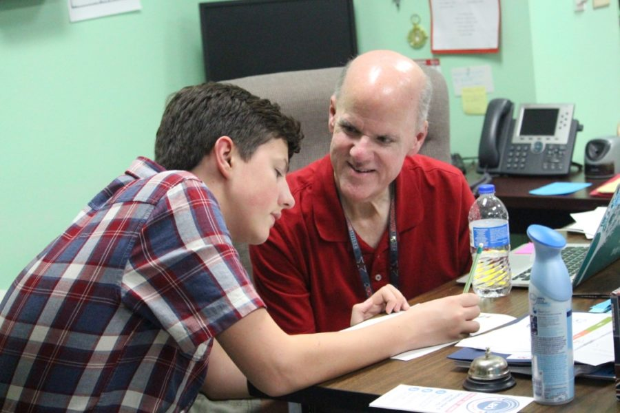 Coppell High School sophomore Cade Wallace and SPED teacher Doug Fowler work together on an a writing activity on Wednesday during fourth period. In addition to teaching, Fowler is an actor involved in the local theatre scene.