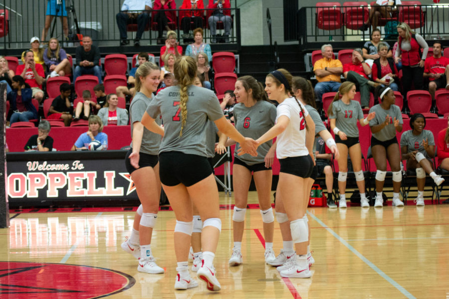 The+Coppell+High+School+Varsity+Volleyball+team+celebrates+their+victory+against+MacArthur.+The+Coppell+Cowgirls+won+the+game+3-0+25-15%2C+25-23%2C+25-6.