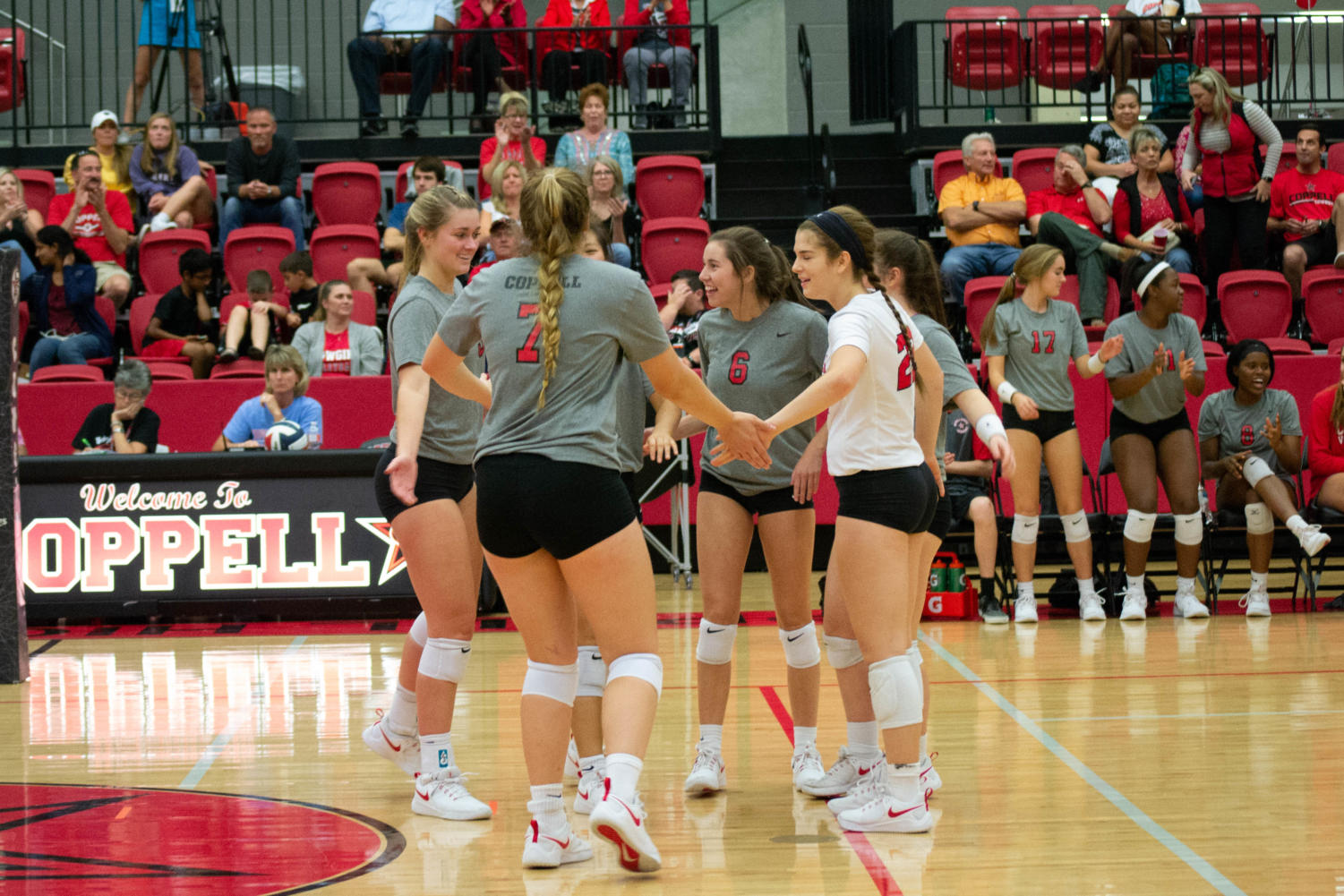 The Coppell High School Varsity Volleyball team celebrates their victory against MacArthur. The Coppell Cowgirls won the game 3-0 25-15, 25-23, 25-6.