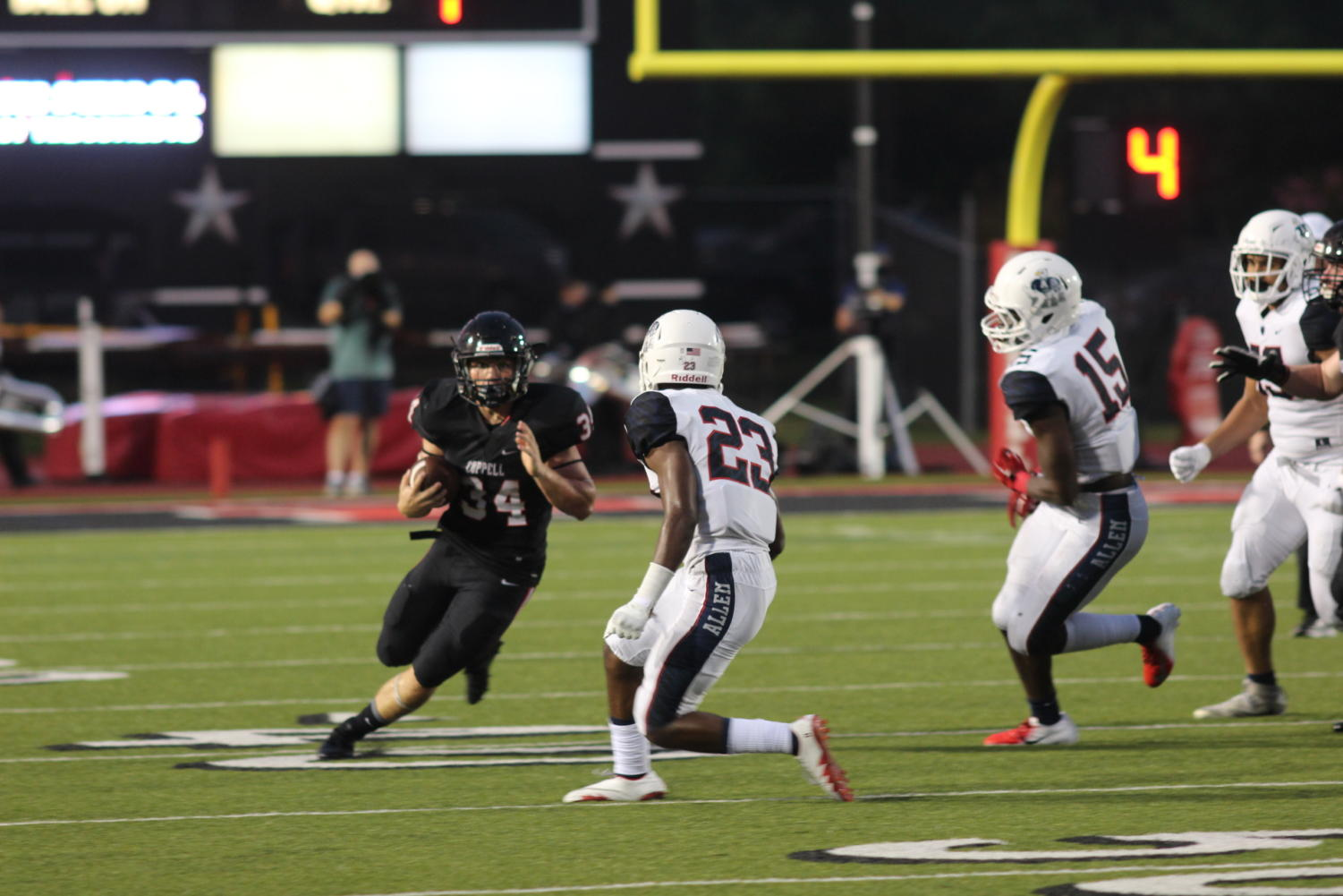 Coppell High School senior running back Ryan Hirt runs past Allen Eagles on an outside run at Buddy Echols Field on Sep. 20 The Cowboys lost to the Allen Eagles, 21-0.