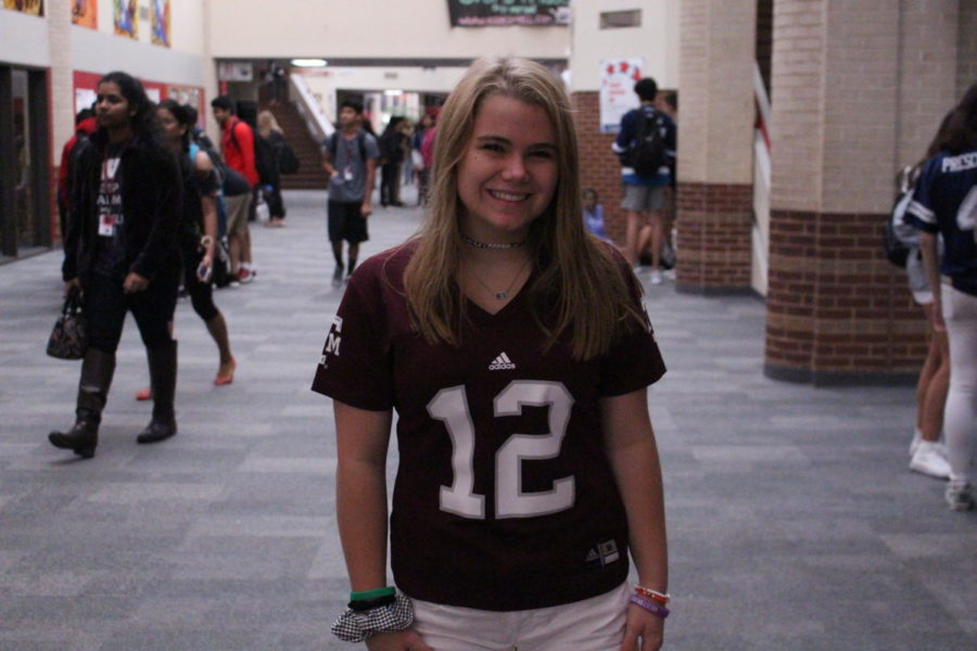 Coppell+High+School+sophomore+Merit+Deppe+wears+her+Texas+A%26M+Aggies+football+jersey+in+the+main+hallway+on+Sep.+27.+Student+Council+is+celebrating+homecoming+week+by+selecting+a+different+dress-up+theme+for+each+day+this+week.