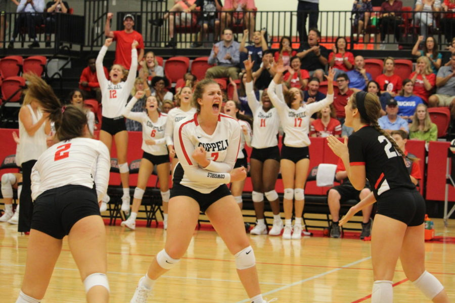 Coppell+High+School+senior+Pierce+Woodall+screams+with+excitement+after+spiking+the+ball+during+the+match+at+CHS+Arena+against+Waxahachie+on+August+11th.+The+Cowgirls+beat+the+Waxahachie+High+School+Indians%2C+winning+2+out+of+3+sets.