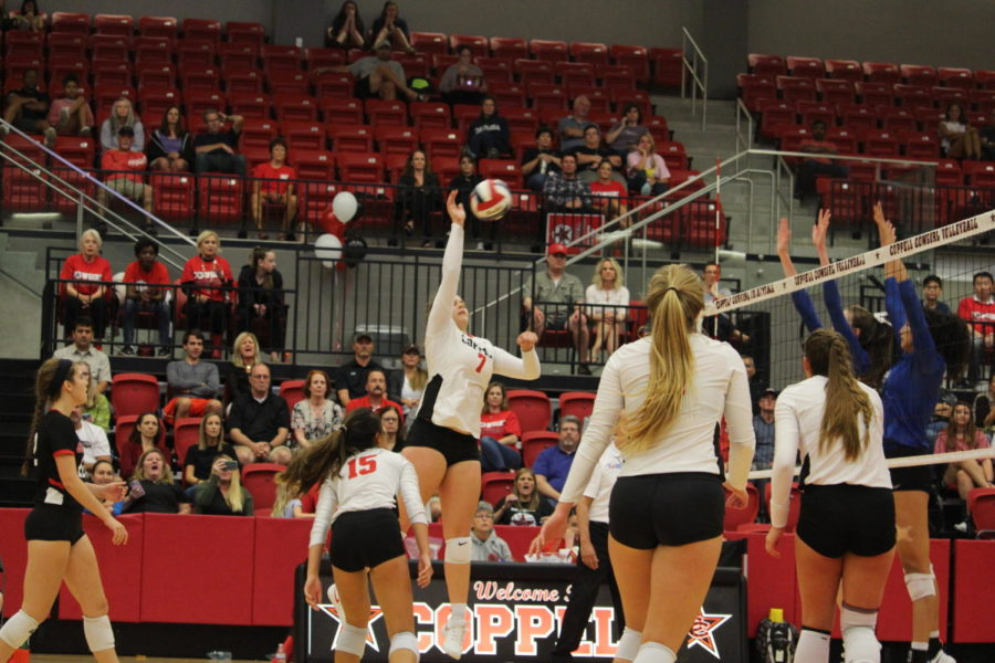 Coppell+High+School+senior+Pierce+Woodall+goes+up+to+spike+the+ball+during+the+match+at+CHS+Arena+against+Waxahachie+on+August+11th.+The+Cowgirls+beat+the+Waxahachie+High+School+Indians%2C+winning+2+out+of+3+sets.