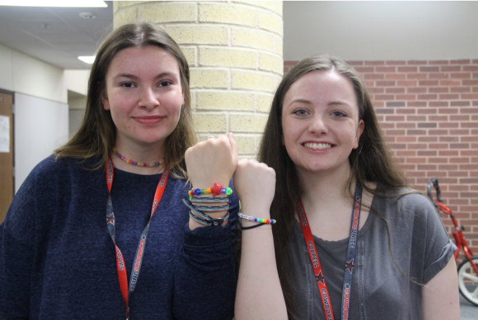"""""""It started just me and Carrie,"""" Coppell High School junior Camryn Rudd said. """"[We] were at Walmart and saw some awesome pony beads and we thought, """"Oh, this could be fun."""" We just started doing it for ourselves and thought, """"Hey, maybe people would buy [bracelets]."""" And so we just made a Google Form and started selling them. We have star beads and we made a black, red and white star necklace and we featured it in one of our pictures and a lot of people liked it. And so we just started making those too for football games. [They're] cowboy colors, so it's kinda cool that we could do that."""""""