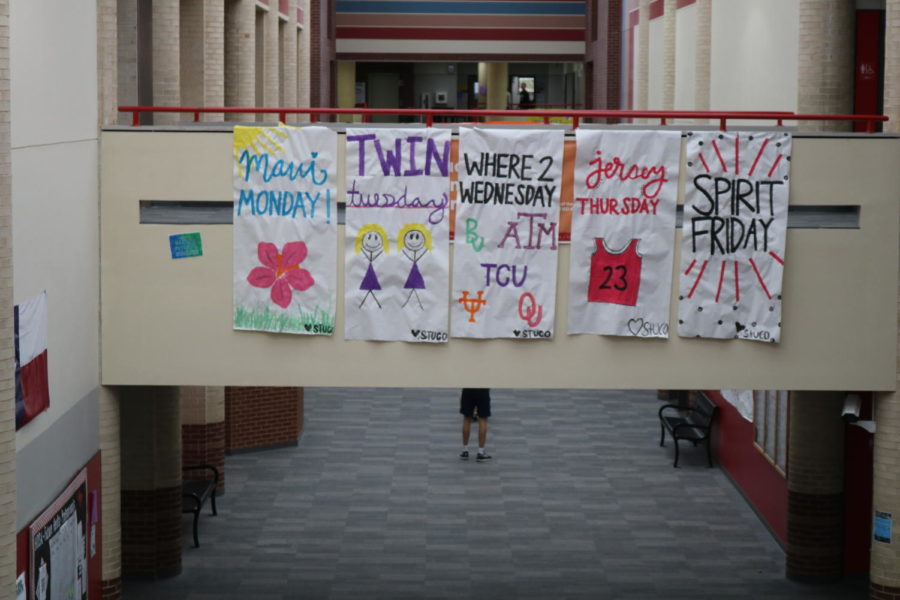 Posters for the daily dress-up themes hang on the senior bridge on Monday, September 24. The Student Council organized dress-up themes and other activities during homecoming week to foster school spirit.