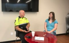 Lewisville resident Cheyenne Baker speaks with Coppell police officer Kirk Smith at the Cozby Library and Community Commons' Human Library event yesterday. The Human Library is a worldwide program that aims to reduce stereotypes and help people better understand others.