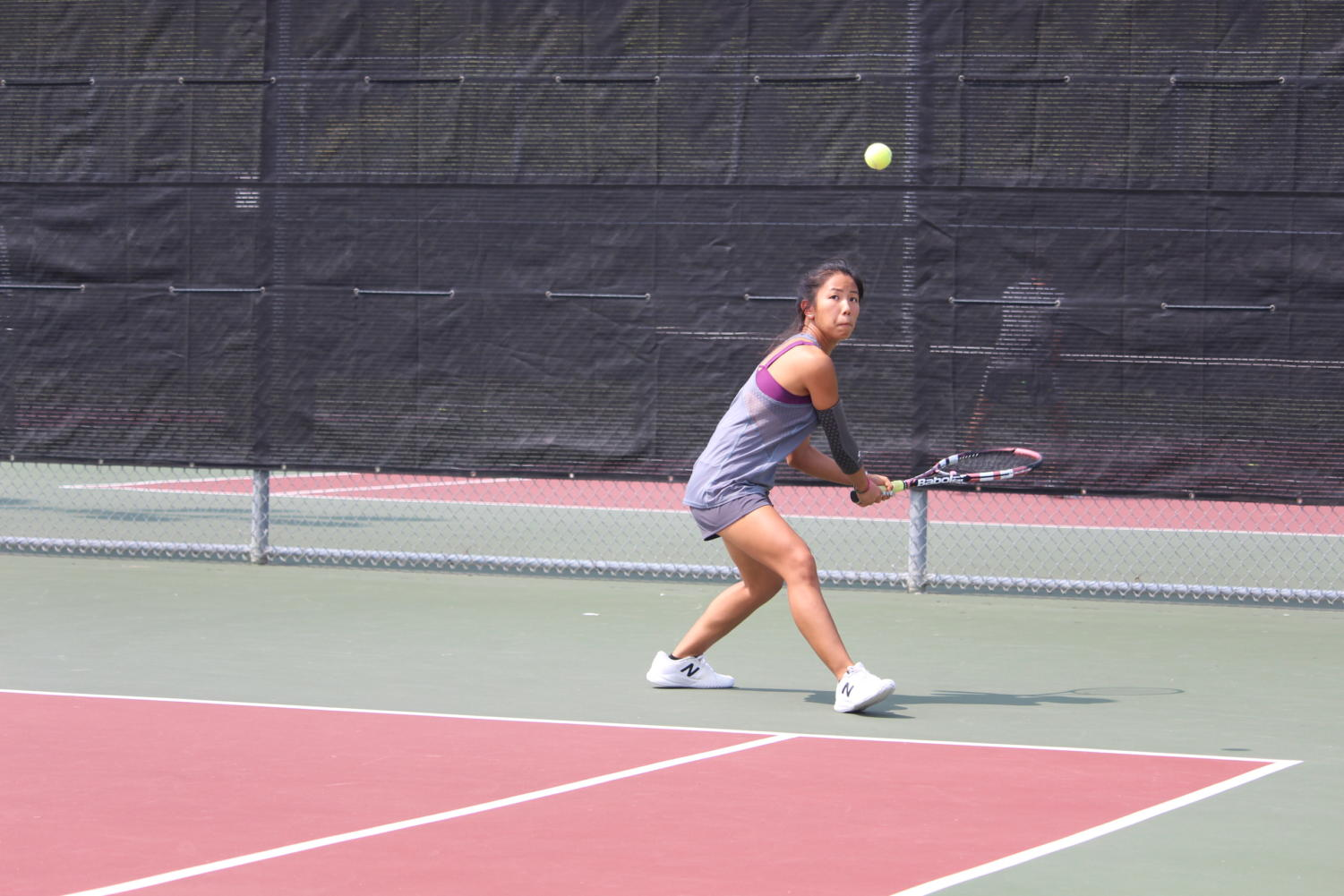 Coppell senior Sydney Nguyen returns a shot during practice earlier this season. The tennis team is facing Marcus tomorrow with their finalized doubles lineup, and is expecting a challenging match.
