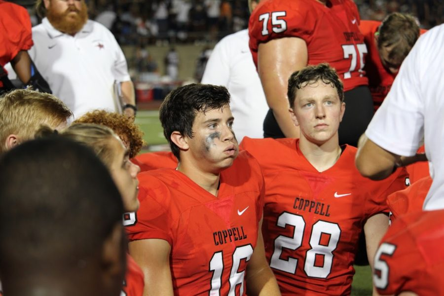 Coppell+Cowboys%E2%80%99+senior+kicker+Caden+Davis+takes+a+knee+after+kicking+57-yard%2C+game+winning+field+goal+on+Aug.+31+at+Buddy+Echols+Field.%C2%A0%C2%A0The+Coppell+Cowboys+defeated+Sachse+Mustangs%2C+30-28.