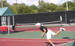 Coppell High School junior Mihiro Suzuki returns the last shot of his doubles match with Coppell High School freshman Andreja Zrnic against Marcus High School on September 18. Suzuki and Zrnic lost 8-6 while the team overall won 12-7.