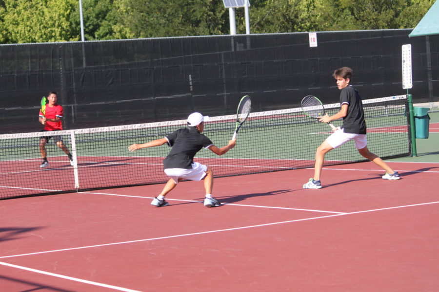 Coppell High School varsity tennis player junior Mihiro Suzuki and freshman Andreja Zrnic dive to hit the ball during their second set against Marcus High School on September 18. Suzuki and Zrnic lost 8-6 while the team overall won 12-7.