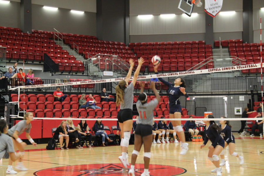 Coppell High School sophomore Madison Gilliland and senior Britney Loyd block the ball during the game in the CHS Arena on September 14th. The Cowgirls defeated the Irving Nimitz in three out of three sets.
