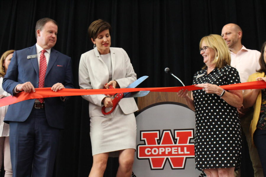 On+Wednesday%2C+Coppell+Middle+School+West+Principal+Emily+Froese+cuts+the+red+ribbon+with+Coppell+ISD+Superintendent+Brad+Hunt+and+CISD+Board+of+Trustees+President+Tracy+Fisher+to+celebrate+the+grand+opening+of+the+new+middle+school.+CMSW+hosted+its+grand+opening+yesterday+to+showcase+the+new+type+of+transparent+and+collaborative+learning+that+would+occur+for+generations+to+come.+