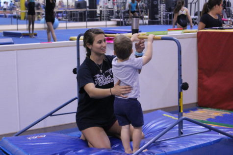 Olson balances coaching, school life through passion for gymnastics (with video)