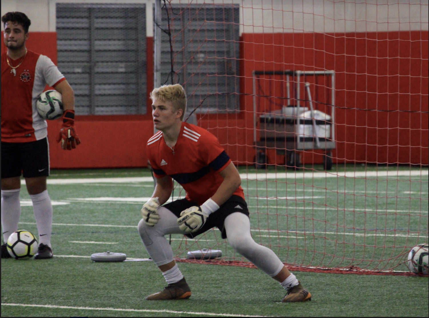 Coppell junior goalkeeper Tommi Penttinen, a foreign exchange student from Finland, practices with his teammates on Friday in the CHS fieldhouse. Penttinen is staying with a host family here in Coppell for a year with a program called Sun Tiimi, which is the local version of a program called International Experience.