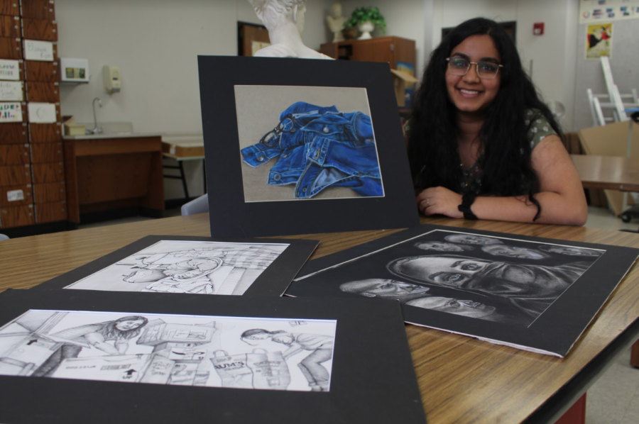 Coppell+High+School+junior+Vaishu+Nalla+holds+poses+with+her+favorite+artwork%2C+titled+%E2%80%9CBillie+Jean.%E2%80%9D+Nalla+made+this+in+her+sophomore+year+using+colored+pencil+and+received+a+silver+medal+after+entering+it+in+VASE.%0A