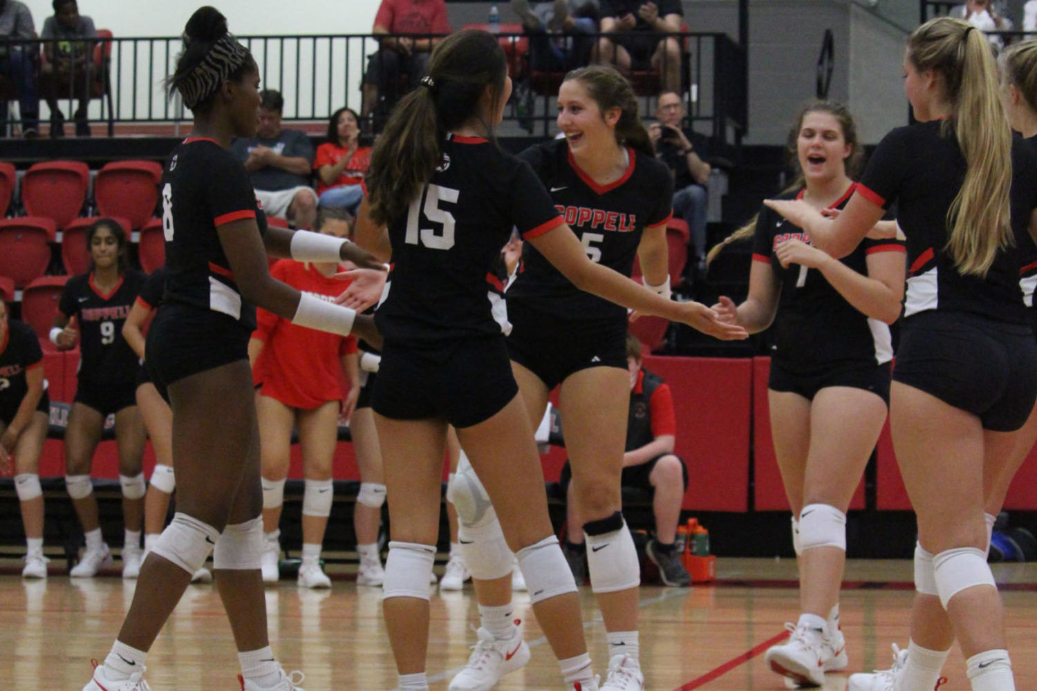 Coppell sophomore middle blocker Madison Gilliland celebrates after a game winning point tonight at the CHS arena on Tuesday. The Cowgirls defeated Keller Central, 25-16, 25-13, 25-17. Photo by Sujeong Oh.
