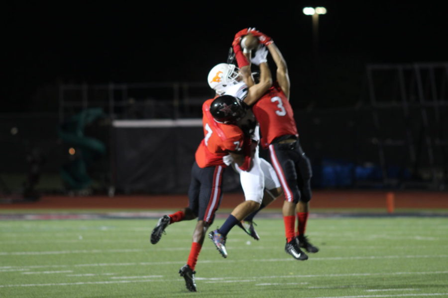 Coppell+Cowboys+senior+Jonathan+McGill+defenses+the+ball+against+Sachse+Mustangs+during+the+fourth+quarter+on+Aug.31+at+Buddy+Echols+Field.++The+Coppell+Cowboys+defeated+Sachse+Mustangs+30+-+28.