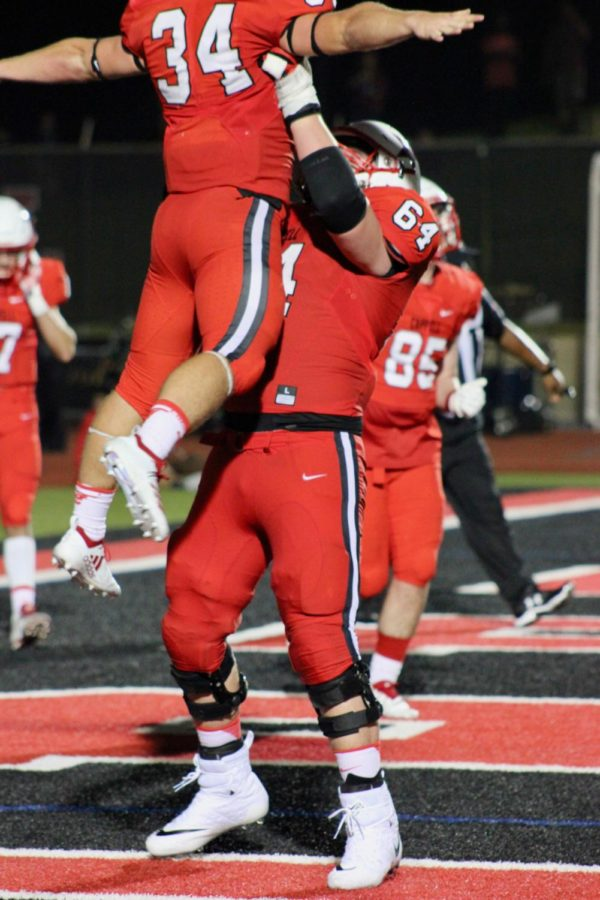 Coppell High School seniors Ryan Hirt and Trevor Stange celebrate for the touchdown Hirt got during the game on Sep. 28 at Buddy Echols Field. Cowboys defeated the MacArthur Cardinals 28-21.