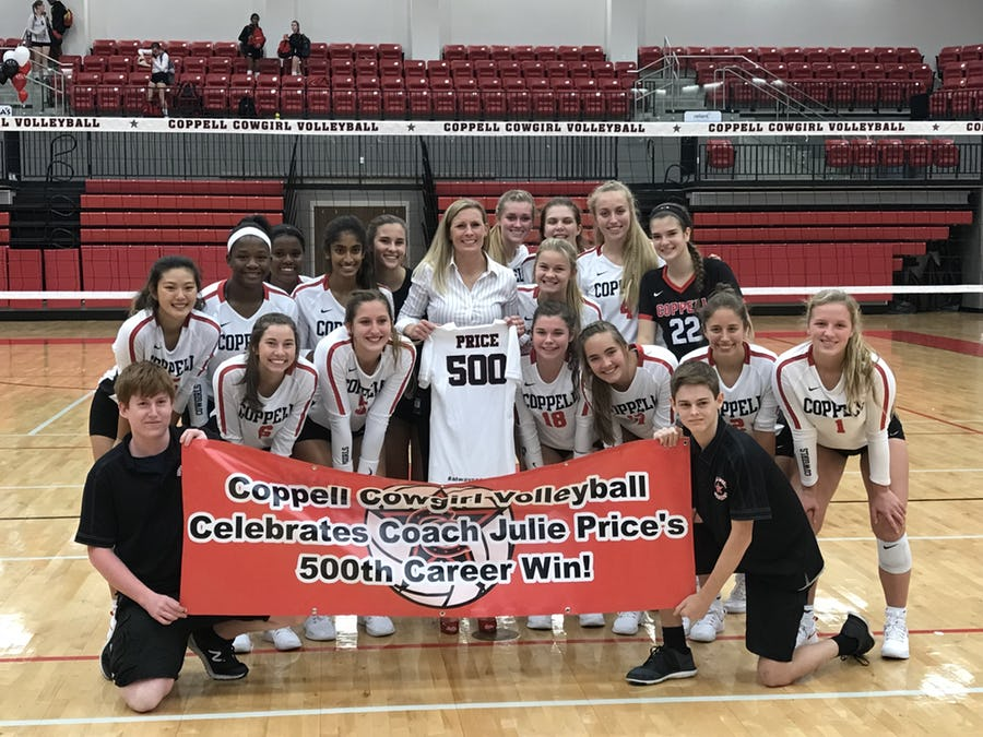 Coppell volleyball coach Julie Price celebrates her 500th career win, with her team. The Cowgirls swept the top-ranked Byron Nelson 25-16, 25-20, 25-18 on Aug. 28.