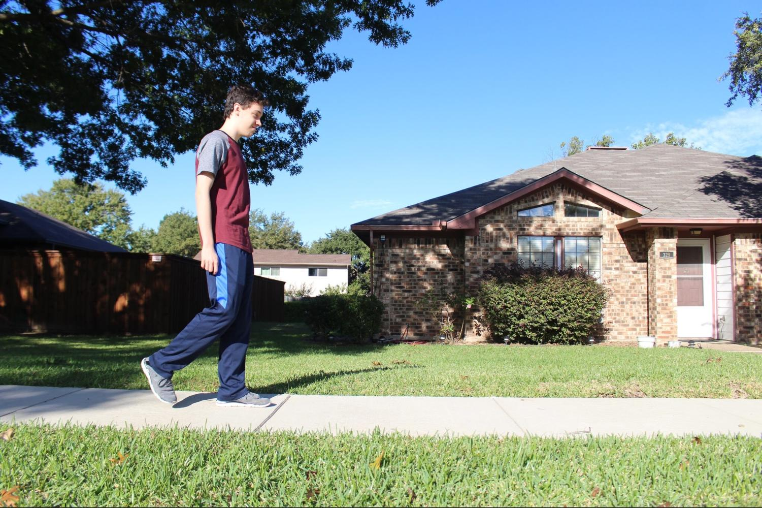 The Sidekick Entertainment Editor Anthony Cesario goes for a walk on Sunday in his neighborhood. Walking has benefitted Cesario through decreased stress, improved mood and a greater appreciation for the outdoors.