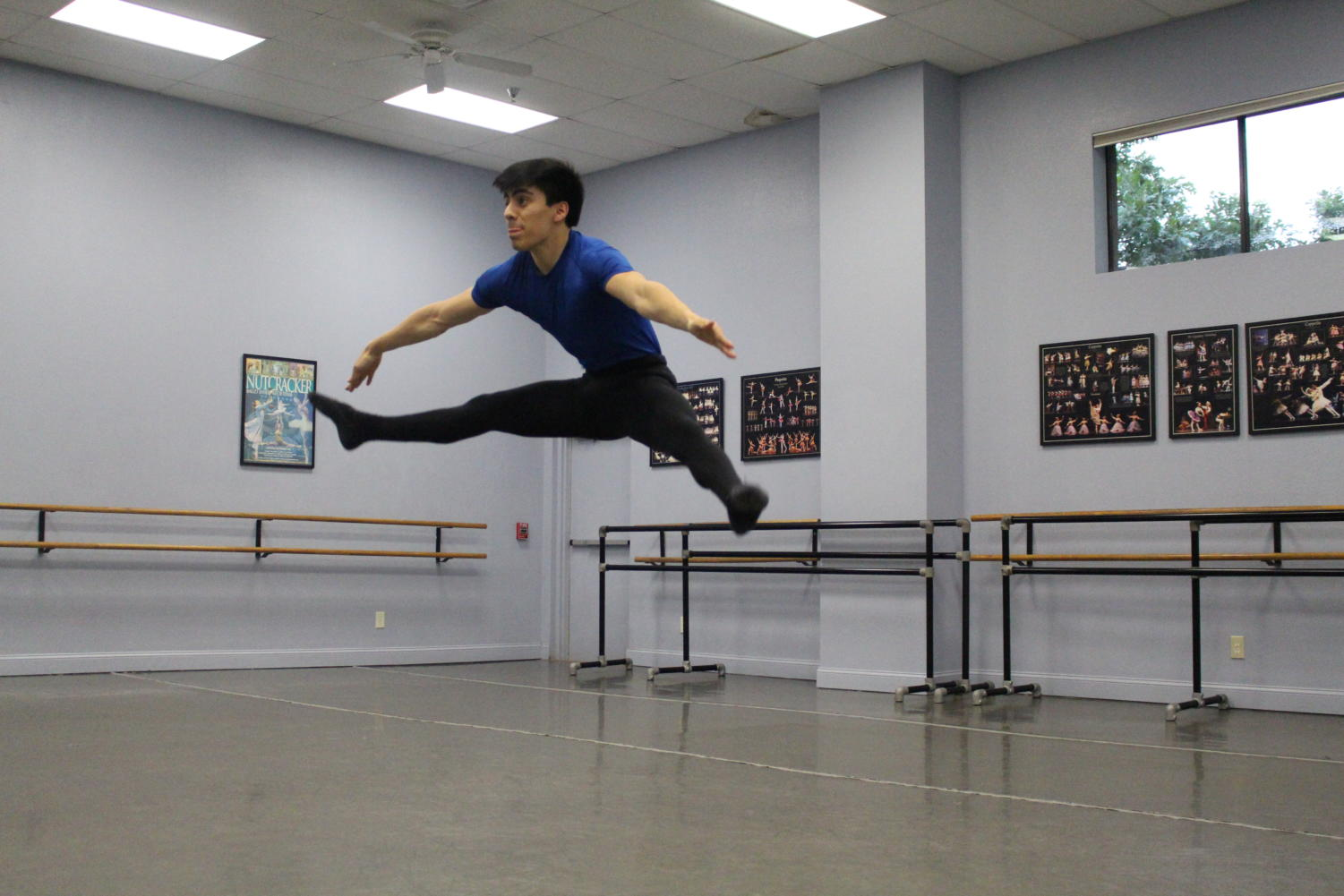 "Coppell High School senior Andrew Mares warms up before his lesson at The Ballet Academy of Texas. Mares has been preparing for his upcoming performance of ""The Nutcracker"" in late November."