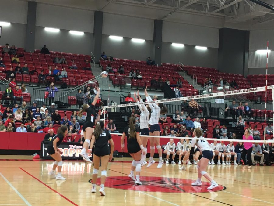 Coppell+High+School+senior+Pierce+Woodall+jumps+to+spike+the+ball+during+the+match+against+Flower+Mound+High+School+on+Oct.+16.+The+Lady+Jaguars+defeated+Coppell+Cowgirls+3+to+1.+Photo+by+Bailey+Lai.