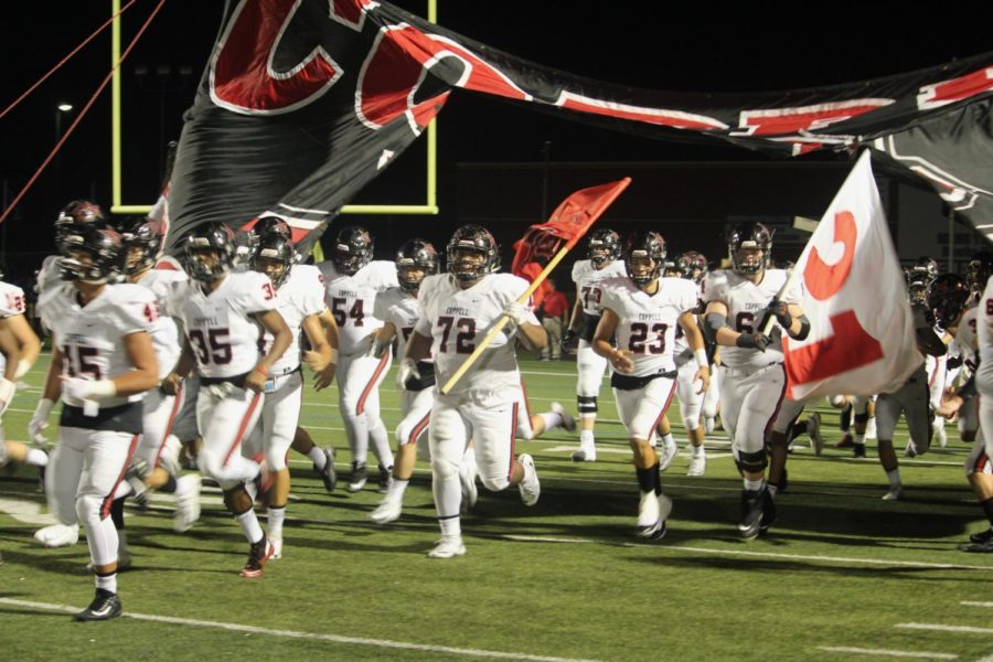 The Coppell Cowboys run out after halftime at Hebron High School statism on Oct. 5. Coppell Cowboys defeated Hebron Hawks 16-15.
