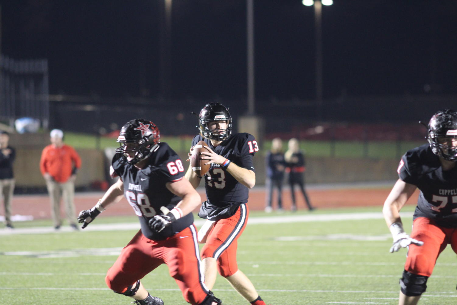 Coppell junior quarterback Drew Cerniglia sets up to throw a pass against Marcus at Buddy Echols Field on Oct. 19. The Cowboys will play Irving tonight at 7 p.m. at Joy & Ralph stadium in Irving.