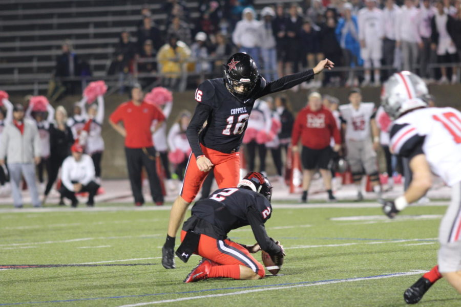 Coppell High School senior Caden Davis kicks a field goal from the 34-yard line with 37 seconds left during the game last night at Buddy Echols Field. The Coppell Cowboys defeated Flower Mound Marcus 24-23.