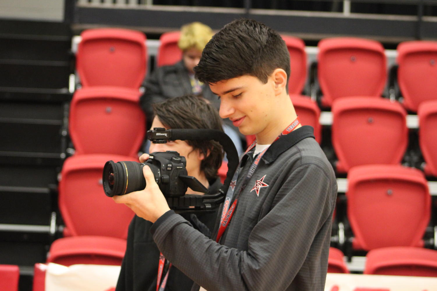 Coppell High School senior Landon Flesher takes video of the pep-rally on Oct. 19, in the CHS arena. Flesher has been a member of KCBY for the past three years of highschool.