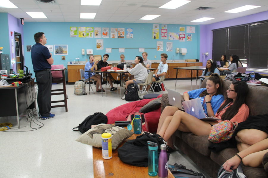 During+seventh+period%2C+student+council+adviser+Jonathan+Denton+discusses+upcoming+plans+for+student+Council.+Student+councils+members+are+preparing+for+homecoming+and+upcoming+by+taking+notes+and+listening+to+Mr.+Denton.