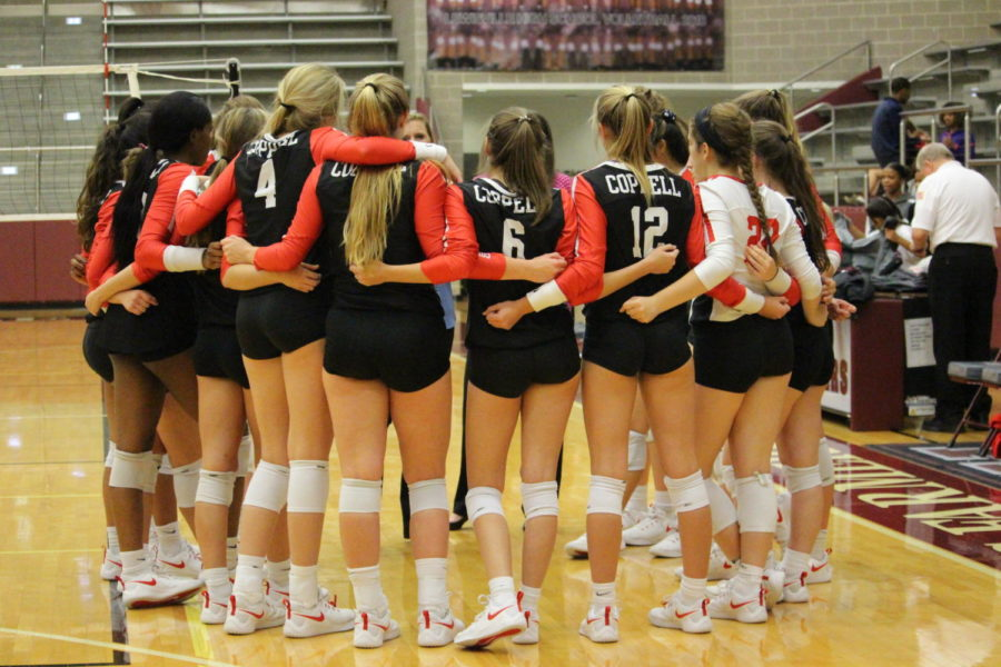 Coppell+volleyball+huddles+at+the+end+of+their+game+to+celebrate+their+win+on+Friday%2C+Oct.+12+at+Lewisville.+The+Coppell+Cowgirls+defeated+the+Farmers+3-0.+Photo+by+Neveah+Jones.
