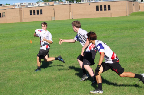 Coppell High School senior's Vinny Vincenzo, Luke Raetzman and Ethan Thompson practice throwing the frisbee among each other while running. They met after school at New Tech High @ Coppell with the rest of the team in order to practice their frisbee skills.
