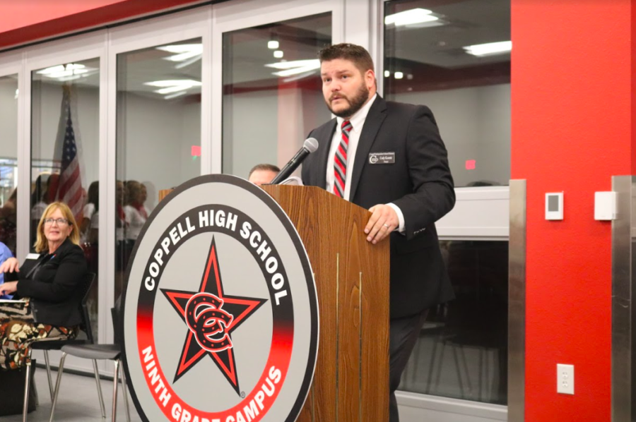 CHS9 Principal Cody Koontz stands at the podium to address the creation of CHS9 and his expectations for the future of the school. Koontz introduces Board of Trustees member Tracy Fisher onto the stand discussing the building of the new ninth grade center.