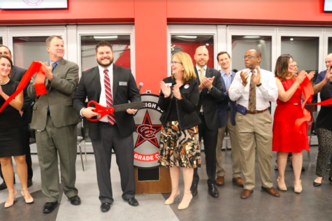 CHS9 Principal Cody Koontz cuts the red ribbon with Coppell ISD Superintendent Brad Hunt and other Board of Trustees members to signify the opening of the Coppell High School ninth grade campus. This new ninth grade center was a result of a remodeling of the former Coppell Middle School West.