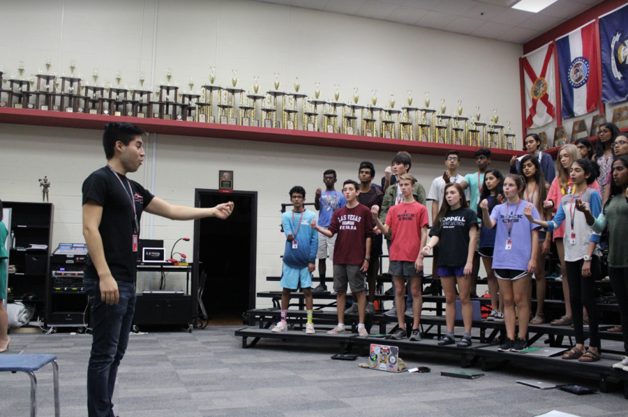 During eighth period, Coppell high school choir director Aaron Coronado goes through warm-ups with his students.  Coronado started his first year teaching at CHS this fall and cannot wait to work with his students.