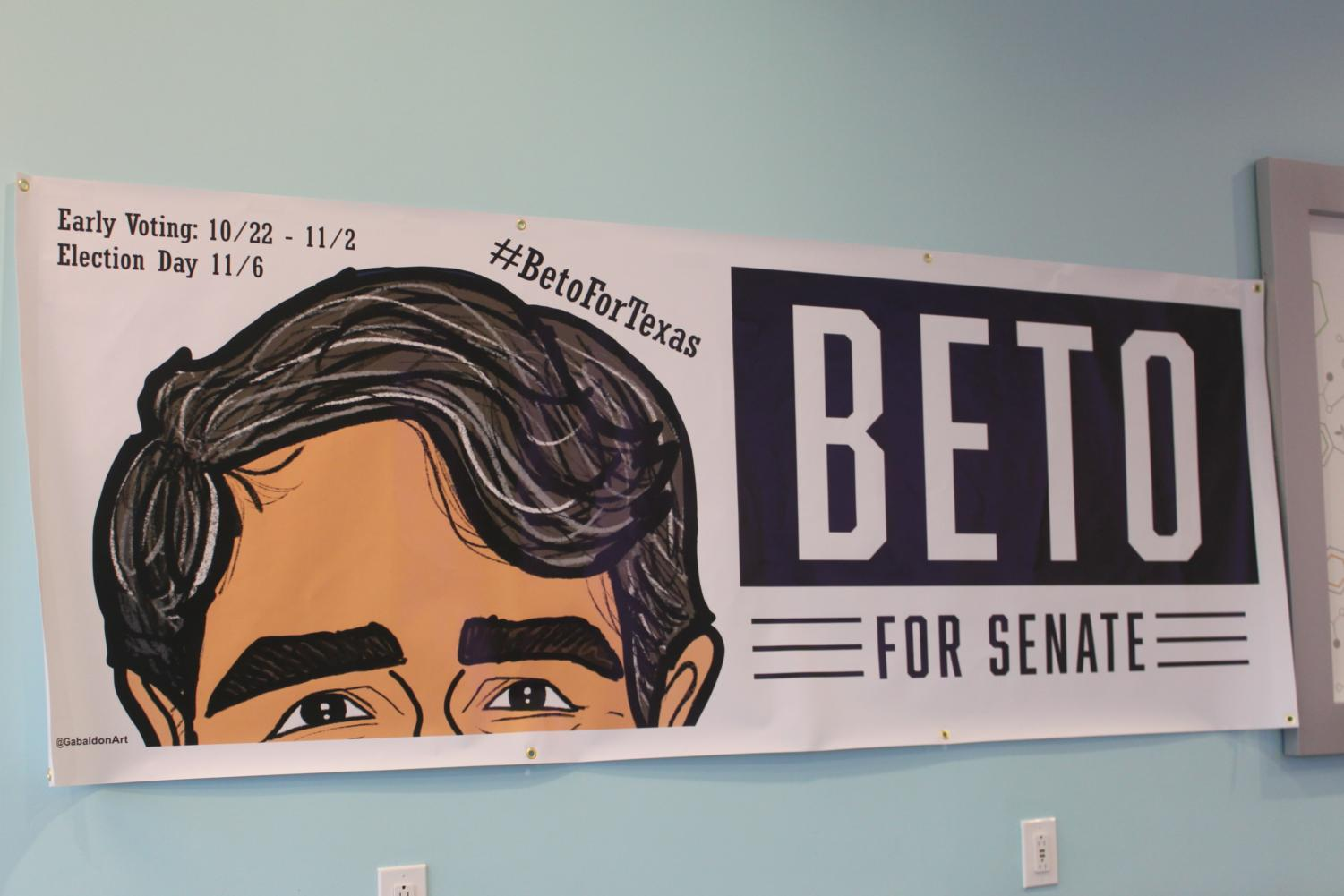 A Get Out The Vote poster shows off O'Rourke's campaign in TCBY, a local frozen yogurt shop and Beto Pop-Up office. Volunteers come here to collect materials, get trained, and call voters to provide them with information about when and how to vote, along with reminders to go to the polls during Early Voting and on Election Day.