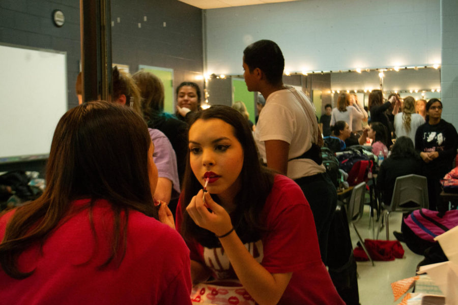 """Coppell High School junior Sophia Sircar prepares for the dress rehearsal backstage for """"All Shook Up"""". Guest can attend the musical this Friday, Saturday and Sunday and as well as Nov. 3- 4.  Photo by Camila Flores."""