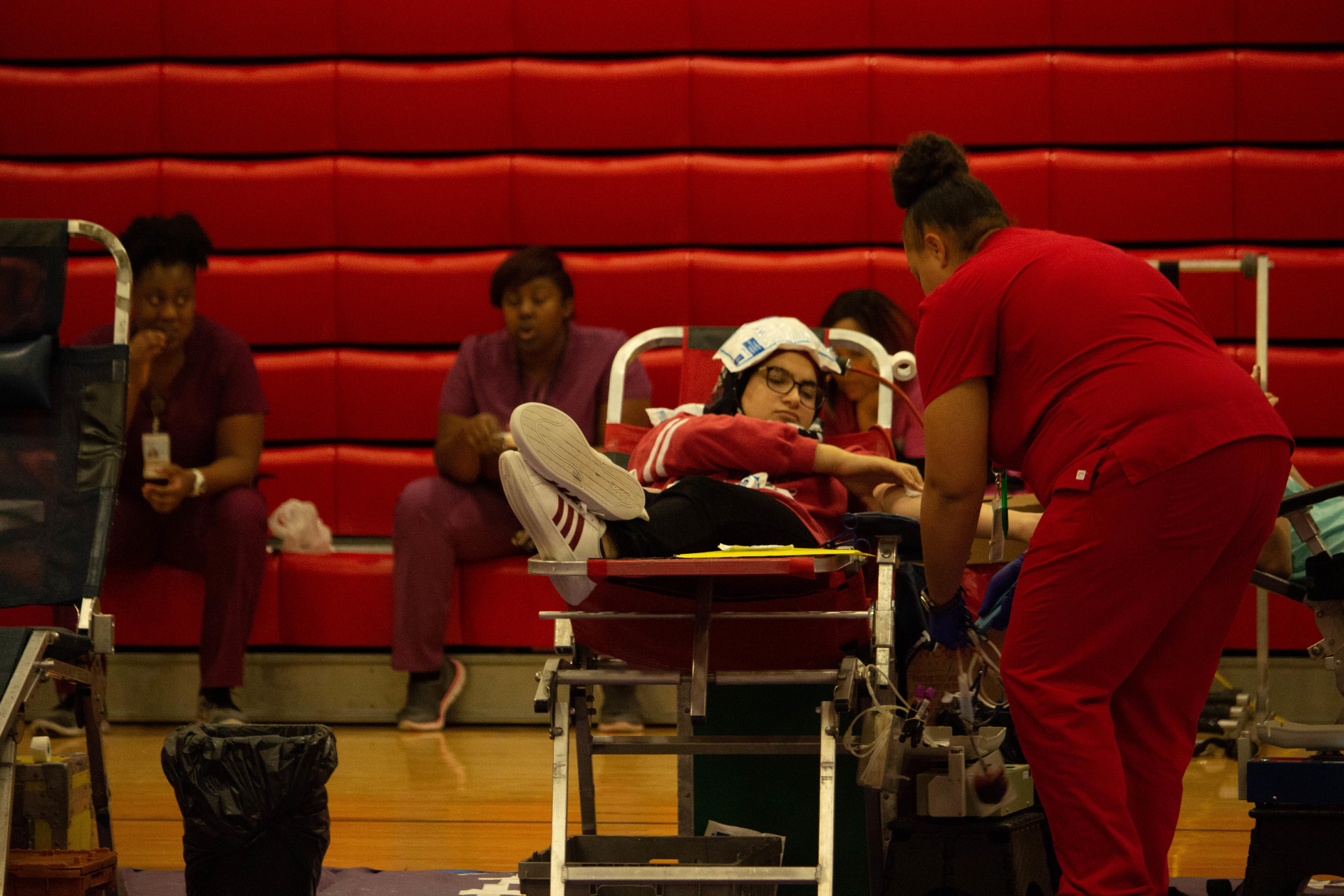 On Oct. 26, Coppell High School junior Saha Saleh gets her blood drawn at the blood drive. The blood drive was held by HOSA and took place all day in the small gym.