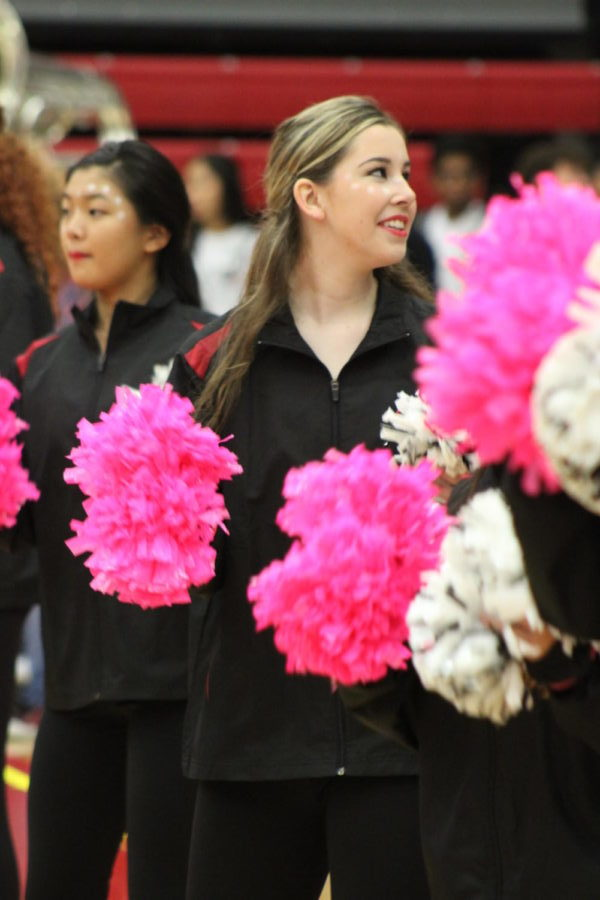 Coppell High School senior Saige Culler performs with the Lariettes during the pep rally on Oct. 18. Culler was a cheerleader throughout her first two years of high school, but became a Lariette her senior year.