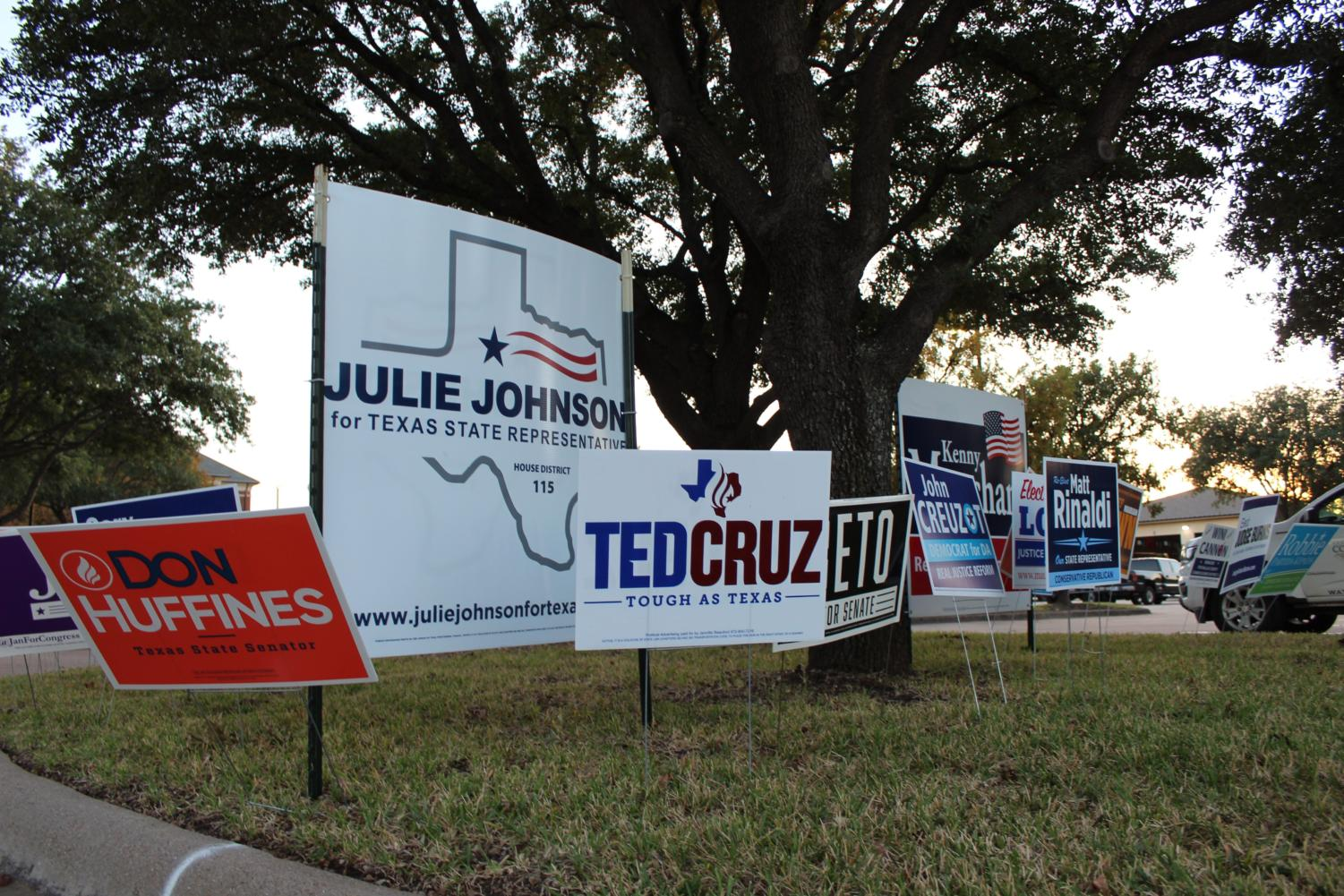 Political signs are lined along the road to Coppell Town Center on Sunday, Nov. 4 for the upcoming mid-term election on Nov. 6. This election will determine which candidates will be elected at the local, state, and congressional level.
