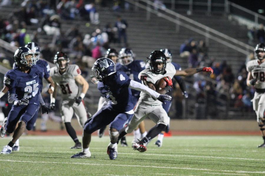 Coppell sophomore running back Jason Ngwu evades defenders against Irving Nimitz at Joy & Ralph Ellis Stadium last Friday. The Cowboys play again tomorrow against Carroll at 2 p.m. at Dragon Stadium in Southlake.