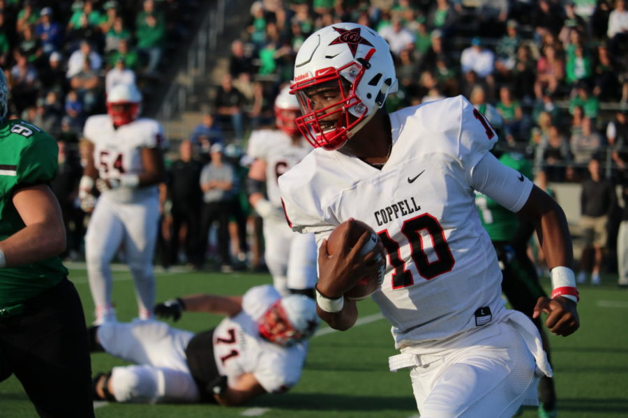 Coppell sophomore running back Jason Ngwu runs the ball for a touchdown on Nov. 17, at Dragon Stadium for Class 6A Region I bi district playoffs. The Cowboys fell to the Dragons 54-10, to end their 2018 season.